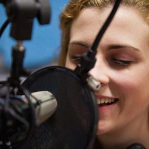 woman-mic - Global Voice Acting Academy